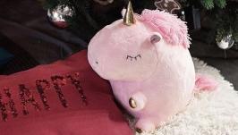 Розовый единорог