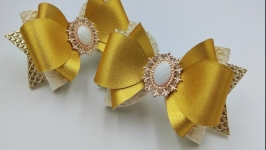 Золотые бантики