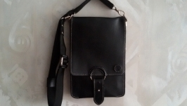 Compact handmade bag made of genuine leather.
