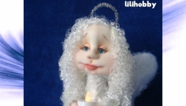 Guardian angel with a candle,doll (in a silver dress)