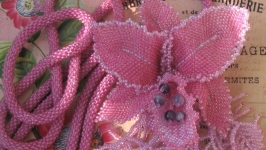 Lariat with the brooch ′Orchid′. Knitted lingonberry plait