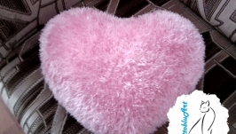 Double-sided pillow. Decorative pillow in the shape of a heart.