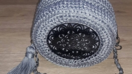 Round knitted handbag.