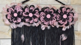 Black and pink jute wall hanging. Vertical Jute tarestry for over a bed
