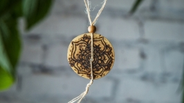 Pendant from a natural tree ′Mandala′