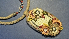 Women′s pendant made of genuine leather with chrysanthemums