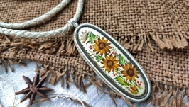 Women′s pendant made of genuine leather with a wooden cabochon and painted