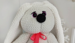 Plush knitted white hare with long ears
