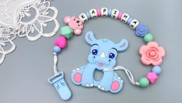 Personalized silicone teether ′Blue Rhino′ with a holder on a clip