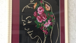 The picture ′Girl with flowers′ (cross-stitch embroidery)