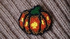 тут изображено Брошка-тыковка Хеллоуин