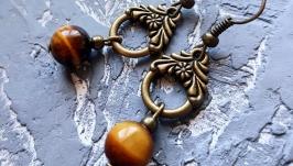 Сережки з натуральними каменем тигряче око серьги коричневые