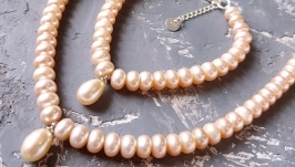 Комплект з натуральних персикових перлів намисто і браслет