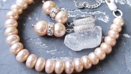 Комплект з натуральних персикових перлів браслет і сережки