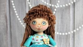 Куколка текстильная в бирюзовом  платьице