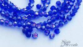 Биконусы хрустальные синие с АВ напылением 2х3 мм
