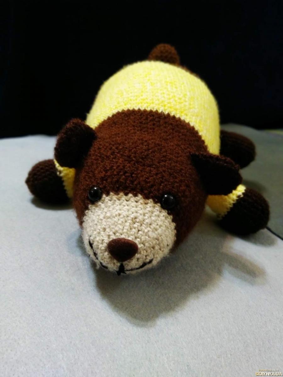 тут изображено Іграшка Ведмедик