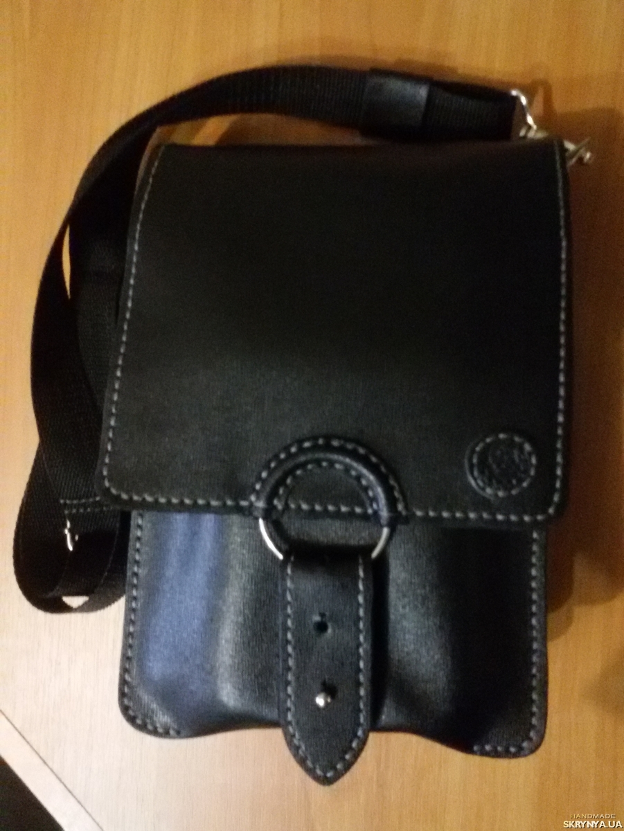 pictured here  Compact handmade bag made of genuine leather.