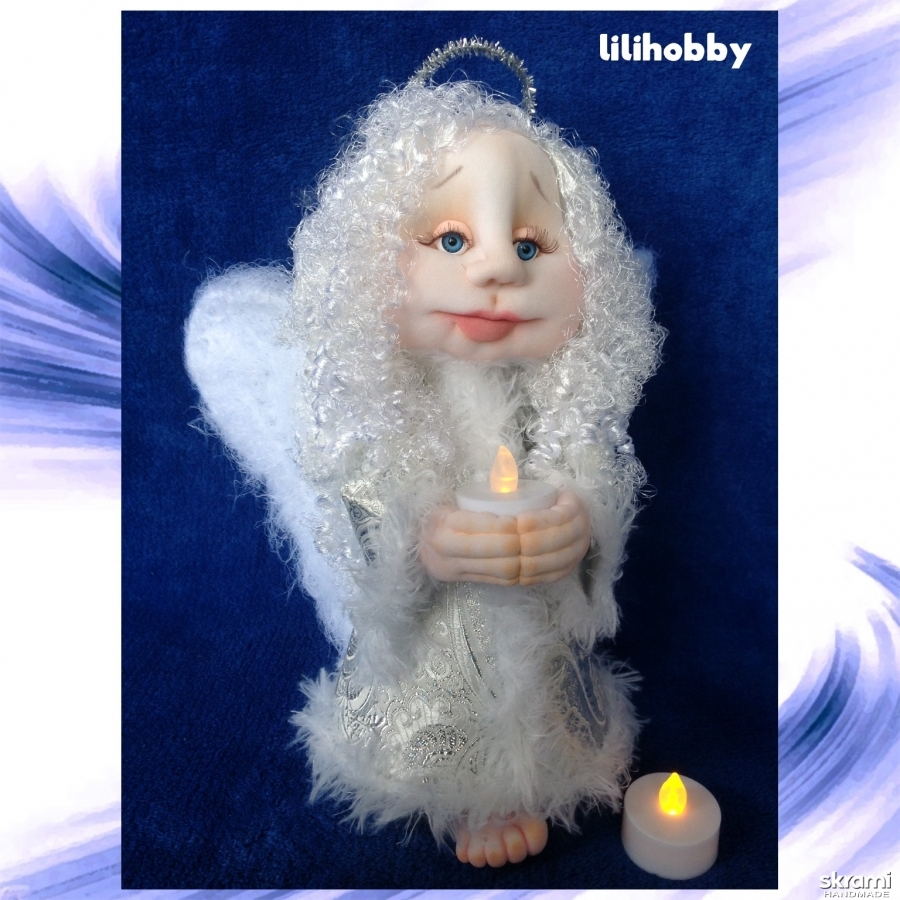 pictured here Guardian angel with a candle,doll (in a silver dress)