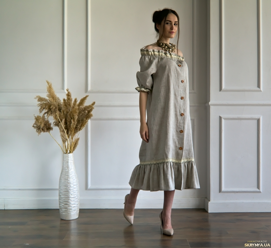 pictured here Linen loose-fit off-shoulder dress with peasant puffed sleeves.