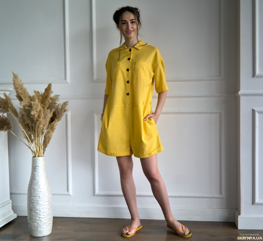 pictured here Yellow Linen women′s jumpsuit with pockets and belt