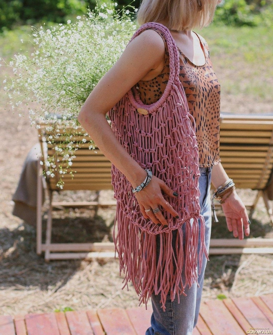 pictured here Knitted string bag from recycled yarn with fringe