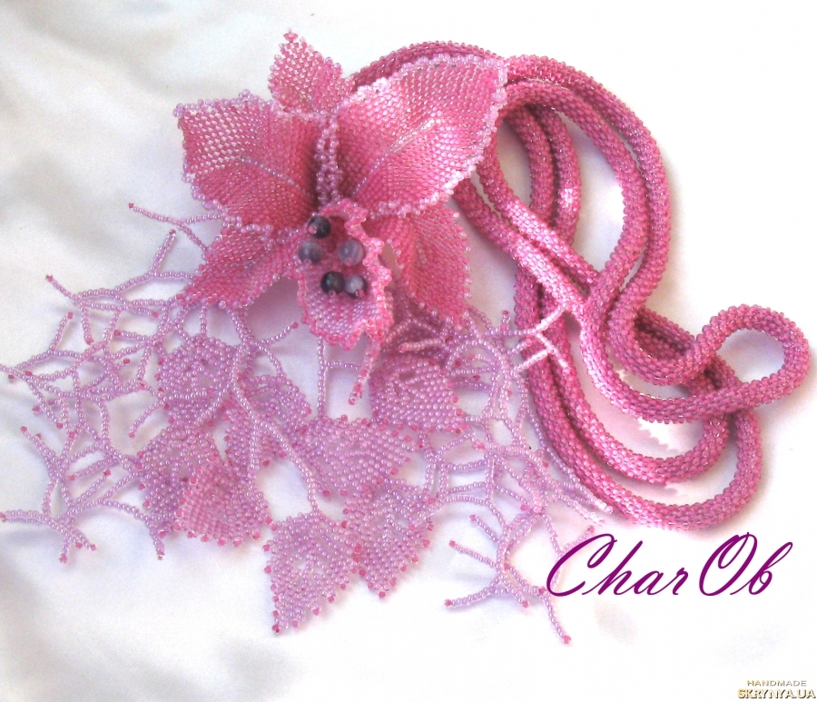 pictured here  Lariat with the brooch ′Orchid′. Knitted lingonberry plait