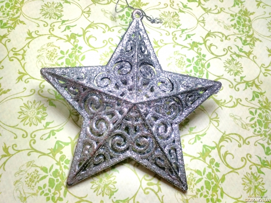 pictured here Christmas decorations figured Star in silver