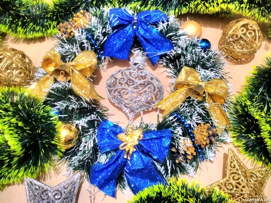 pictured here Christmas wreath on the door of the middle size
