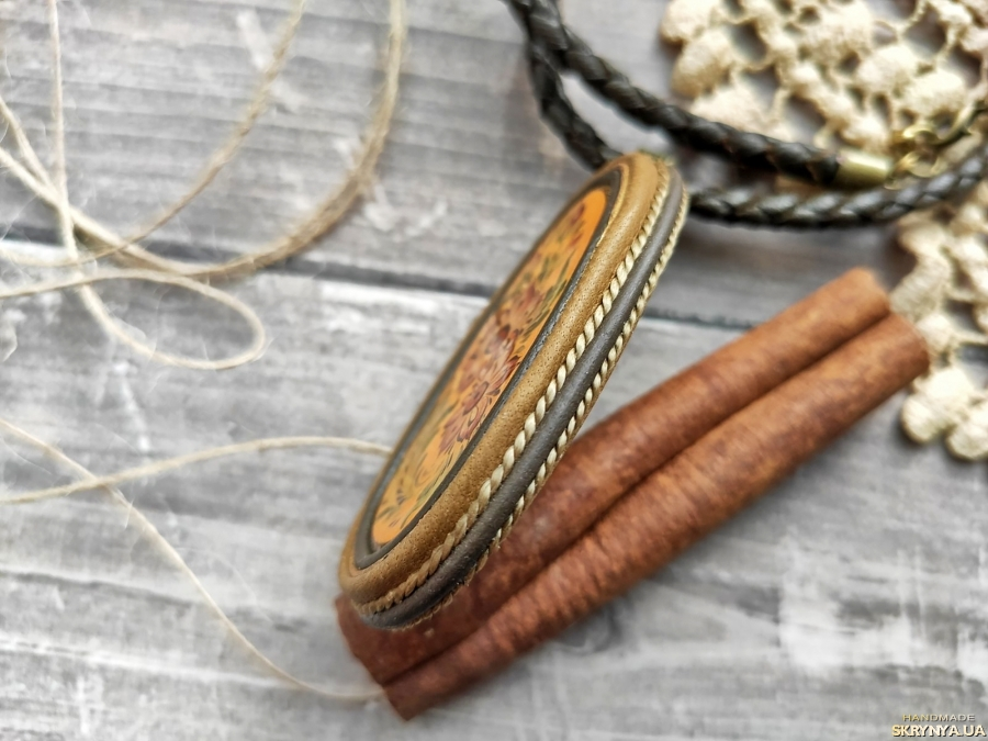 pictured here Women′s pendant made of genuine leather with a wooden cabochon and painted