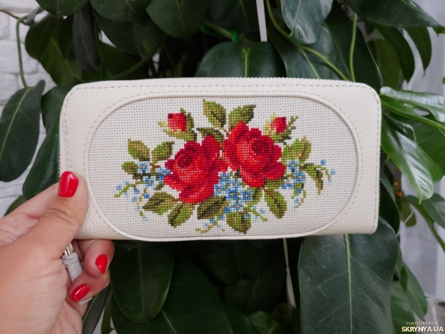 pictured here  Wallets made of genuine leather. Hand embroidery cross