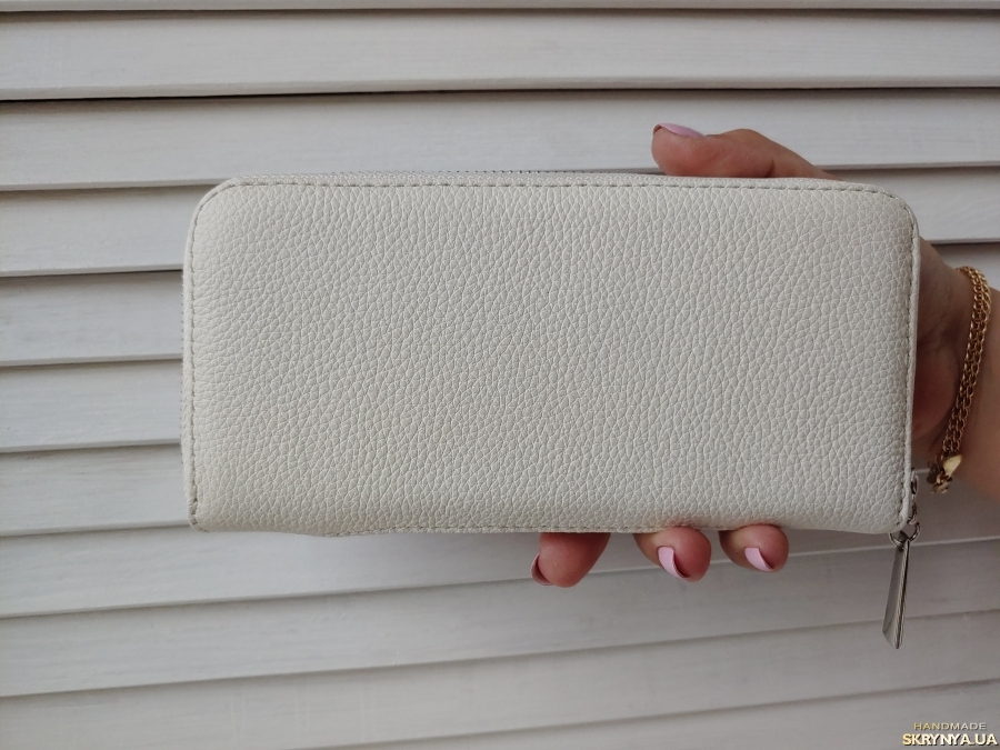 Wallets made of genuine leather. Hand embroidery cross