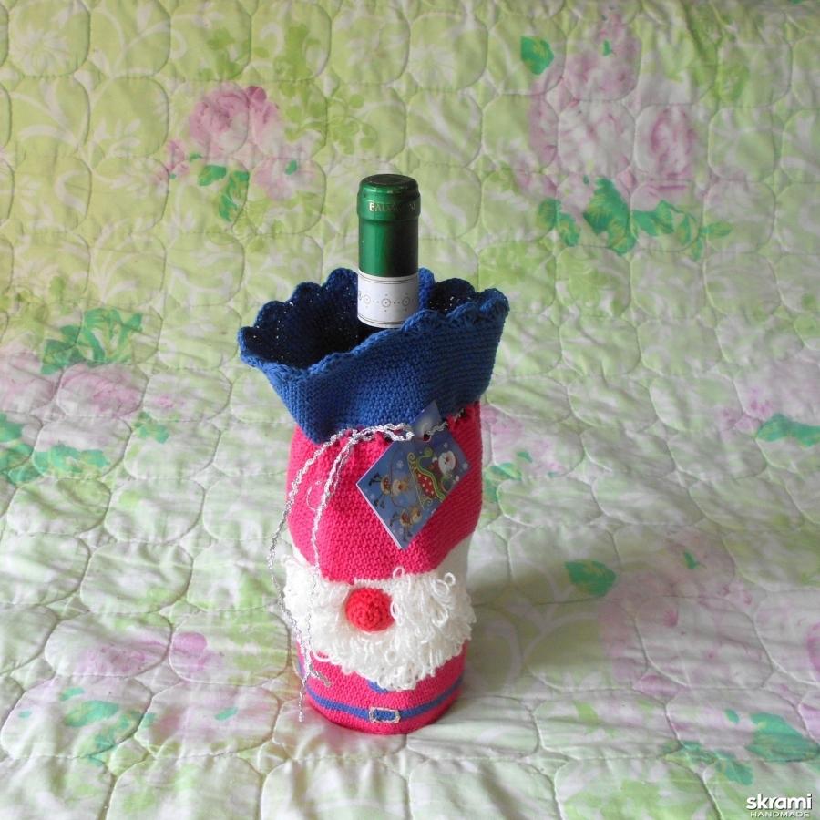 тут изображено Футляр для бутылки шампанского, вина, воды, футляр в виде Деда Мороза