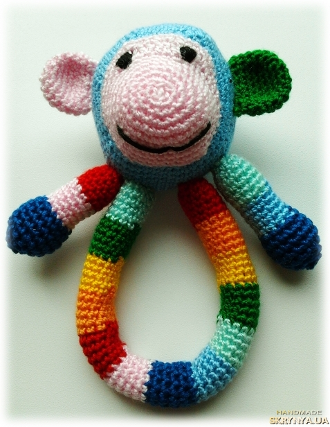 тут изображено Погремушка - обезьянка
