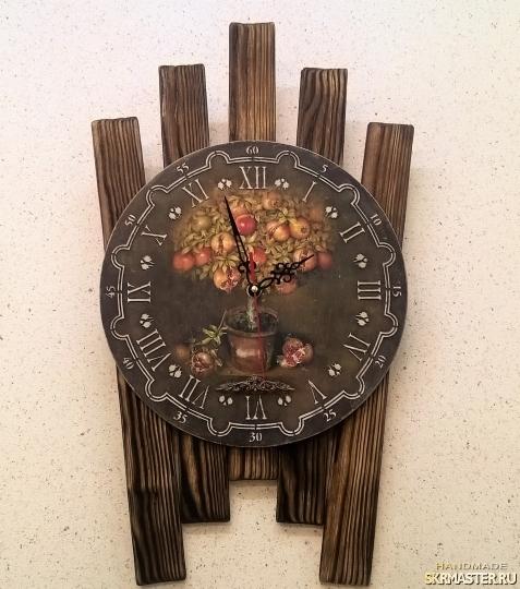 тут изображено Часы ′Гранатовое дерево′