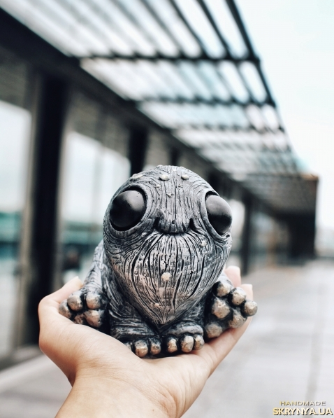 тут изображено скульптура глазастик