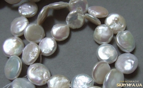 тут изображено Намистина. річкові пели.природні культивовані перли