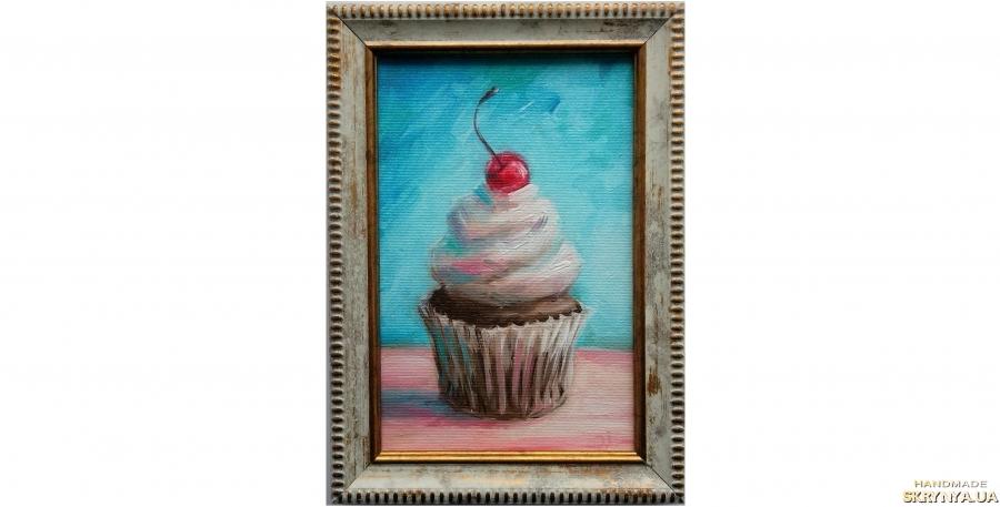 тут изображено картина кекс кексик пирожное с вишенкой вишней