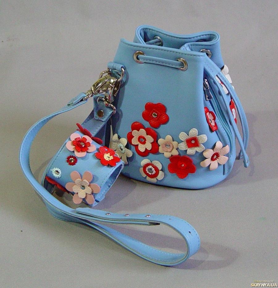 тут изображено Кожаная сумка-мешок
