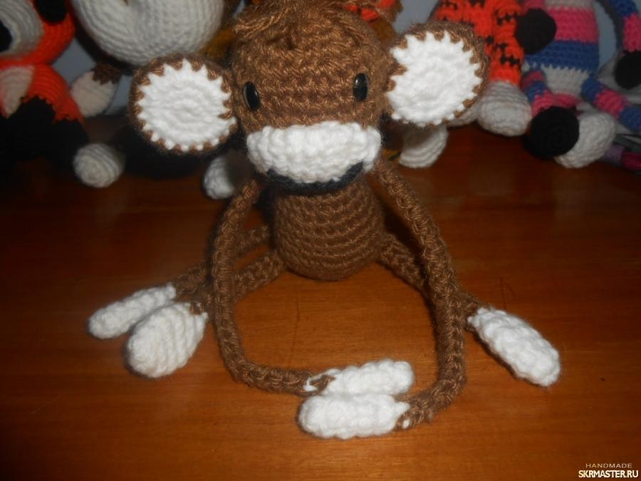 тут изображено обезьянка- зажим для штор