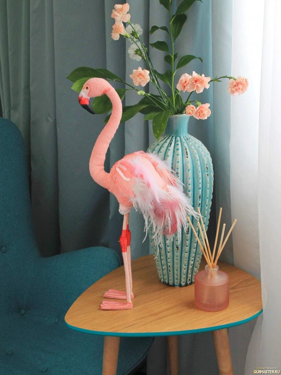 тут изображено Розовый фламинго